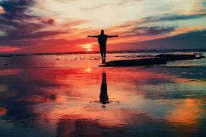 Man facing sunset